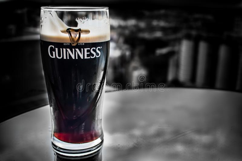 DUBLIN, IRELAND - FEBRUARY 7, 2017: A pint of Guinness on a stand. Almost ready to drink inside the Guinness Storehouse royalty free stock image