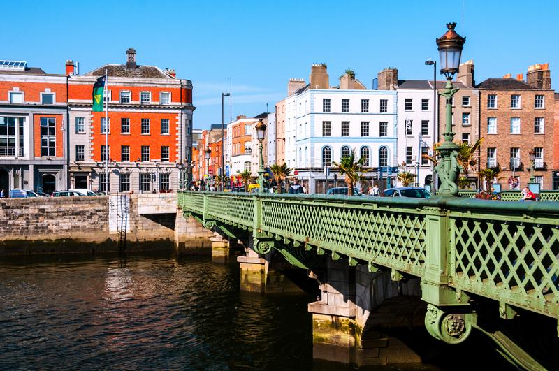 Grattan Bridge at day in Dublin, Ireland. Beautiful architecture. Dublin, Ireland. Grattan Bridge at day in Dublin, Ireland. Beautiful architecture. Car traffic stock photography