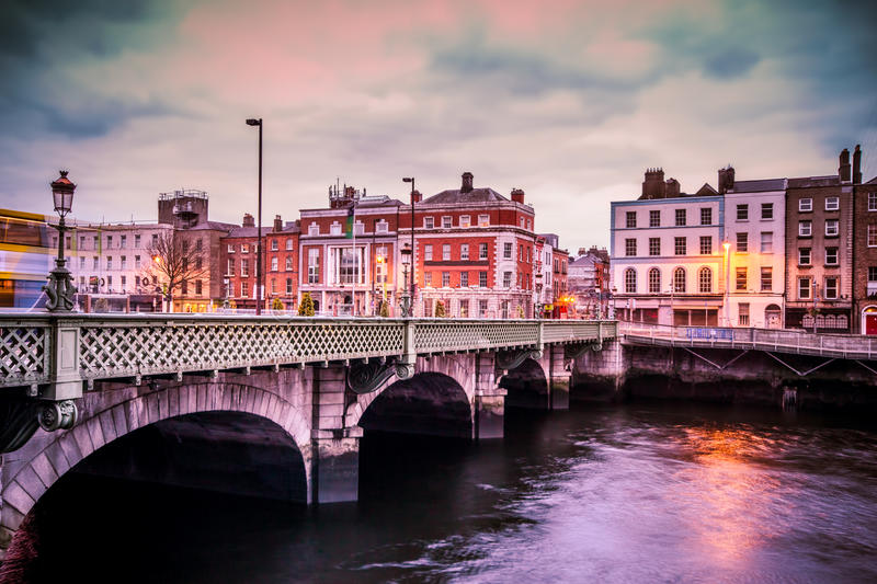 Dublin Ireland Grattan Bridge. Historic Grattan Bridge over the River Liffey in Dublin Ireland at sunset stock photos