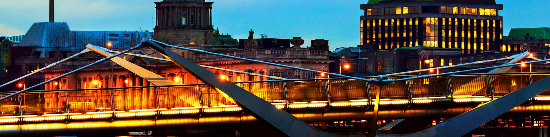 Illuminated Sean O`Casey Bridge with the Custom House in Dublin, Ireland at night stock photo