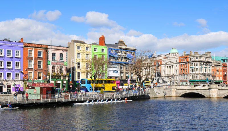 Dublin. Ireland - 30 March, 2013: Tourists admire landmarks on s quays along the river Liffey