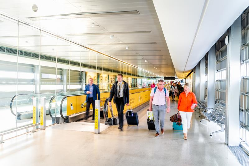 Dublin, Ireland, May 2019 Dublin airport, people going to passport control after arrival. Long corridor with moving walkway, motion blur royalty free stock images