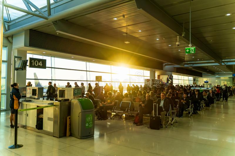 Dublin, Ireland, May 2019 Dublin airport, people waiting for their flights. Departure hall and boarding gate, sunrise stock photo