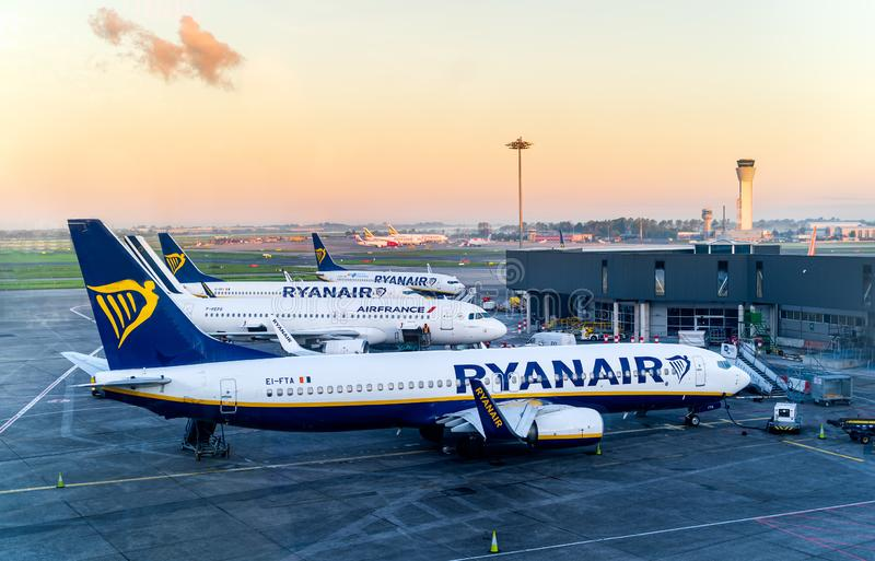 Dublin, Ireland, May 2019 Dublin airport Terminal 1, multiple airplanes are being prepared on airfield for flights. Sunrise stock image