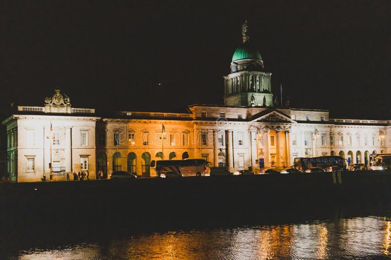 DUBLIN, IRELAND - November 9th, 2018: night time shot of the Custom House building reflecting on the river Liffey in the centre of royalty free stock photography