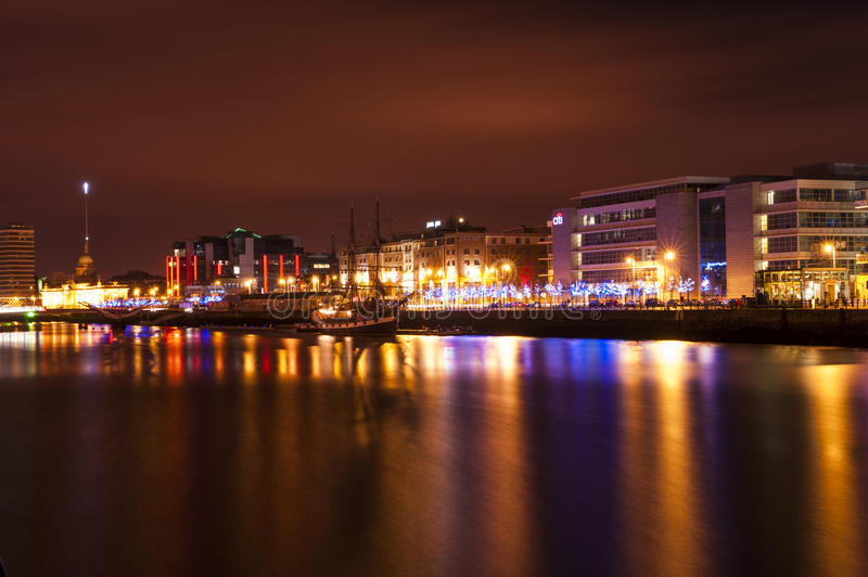 Dublin at night over the river Liffey stock images
