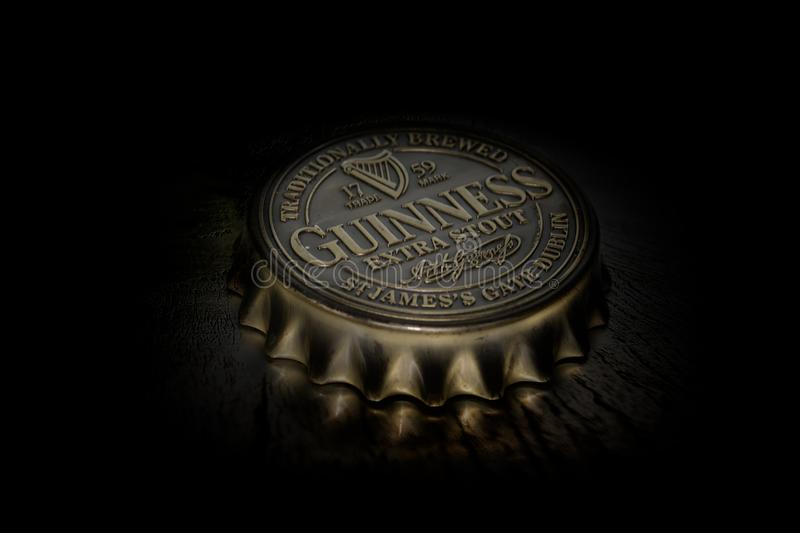 Guinness bottle top. Dublin Nov 23 2017: Famous Irish bottle top originated in the brewery of Arthur Guinness at St. James`s Gate brewery Dublin Ireland royalty free stock photography