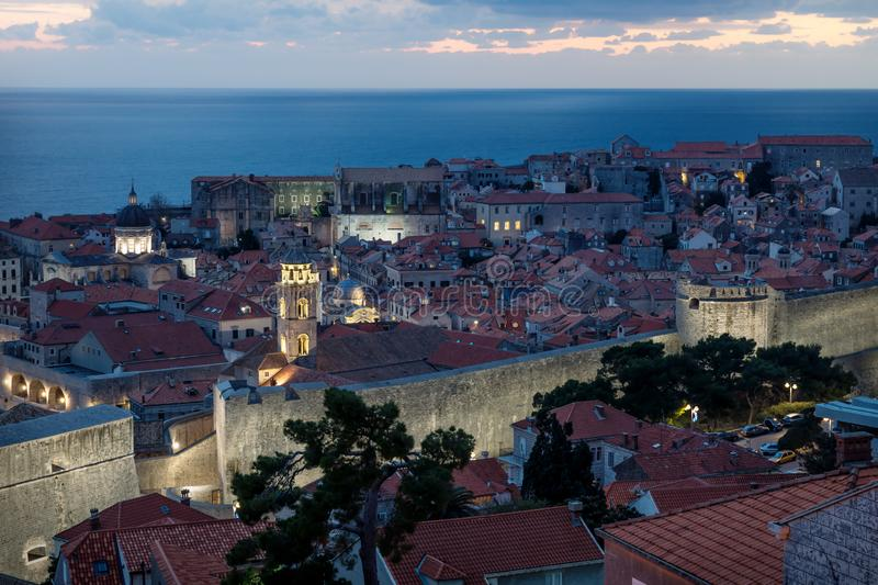 Dubrovnik aerial close up night view after sunset with dramatic cloudscape, Croatia royalty free stock photography