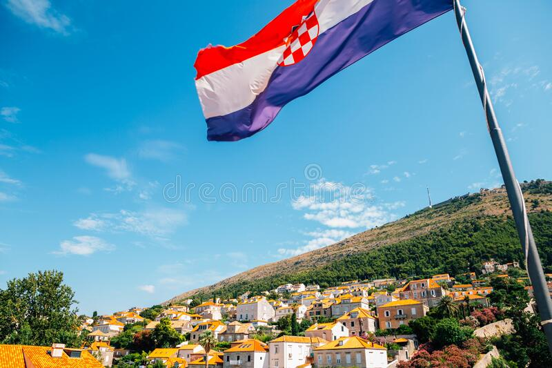Dubrovnik city and national flag in Croatia. Europe stock photography