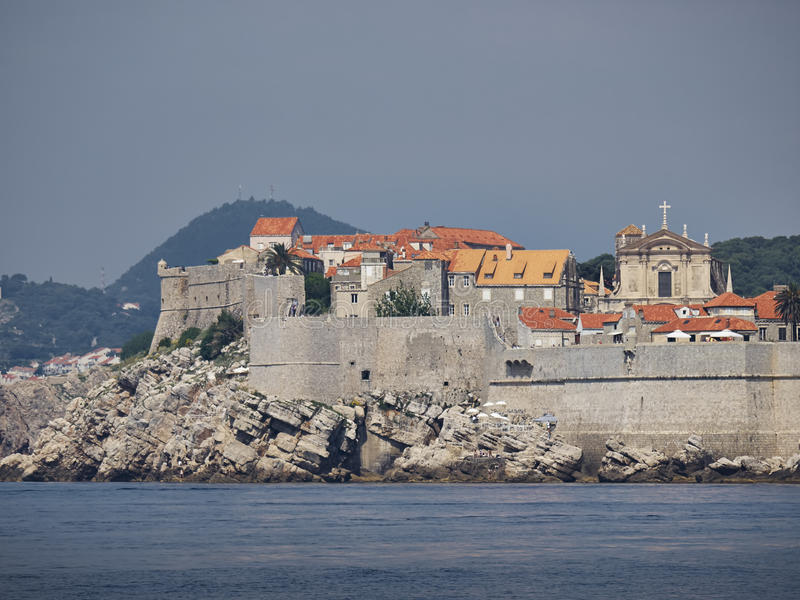 Dubrovnik city wall. Front view from the sea stock images
