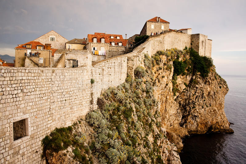 Dubrovnik city wall at sunset. Dubrovnik city wall on the sea cliff royalty free stock photos