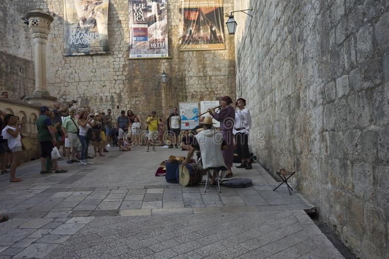Orchestra at the entrance of Dubrovnik city walls stock photos