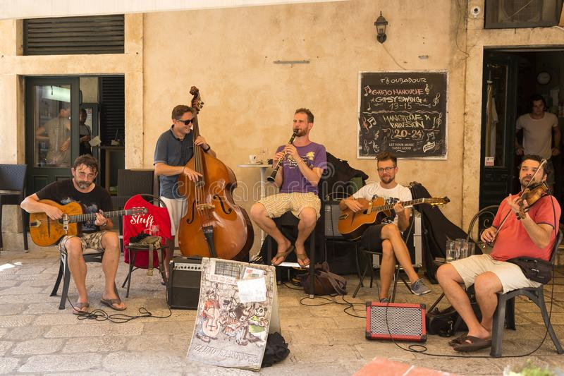 Quartet of street musicians entertains tourists royalty free stock photography