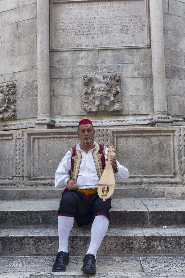 Traditional Musician in Dubrovnik stock photos
