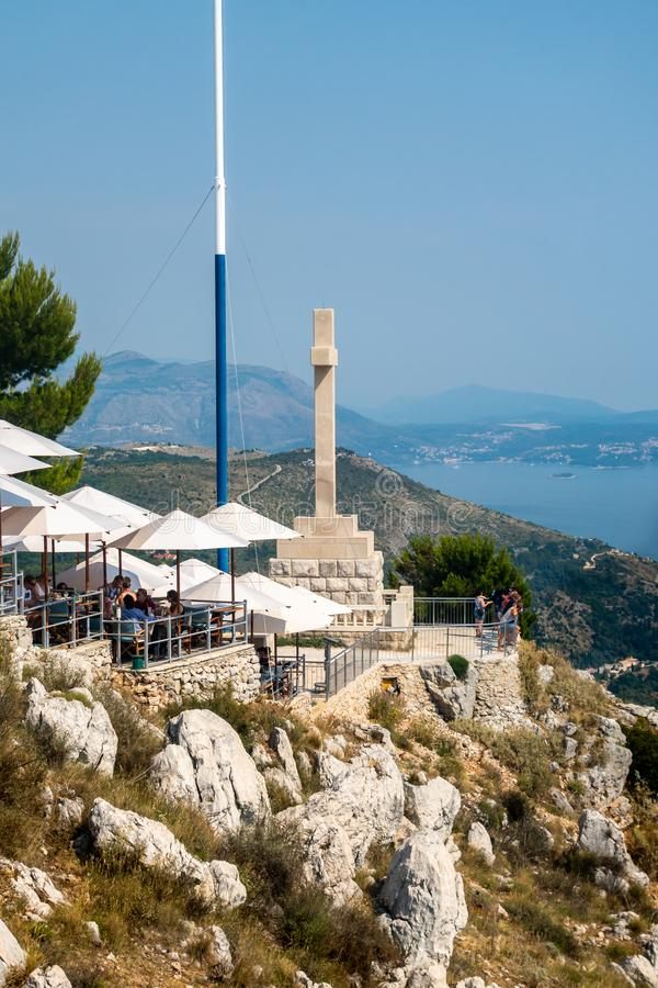 Top view of people at a restaurant on a mountain top with the Adriatic sea in the background. royalty free stock photo
