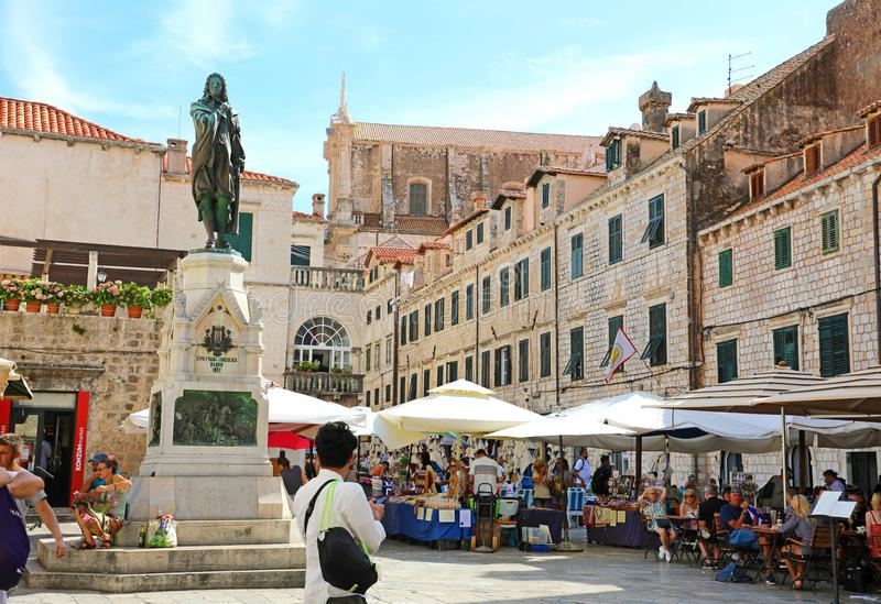 DUBROVNIK, CROATIA - JULY 11,2019: Main Gundulic Square with sculpture of Ivan Gundulic royalty free stock images