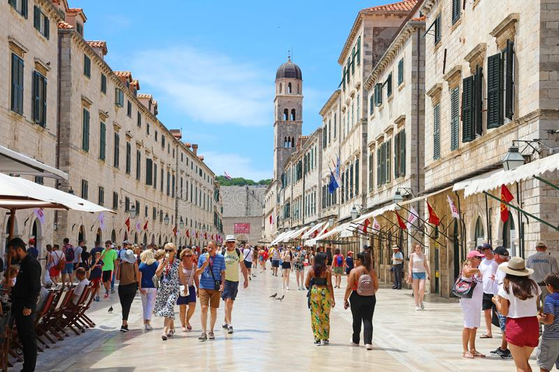 DUBROVNIK, CROATIA - JULY 12, 2019: tourists walking in Stradun main street in Dubrovnik, Croatia royalty free stock images