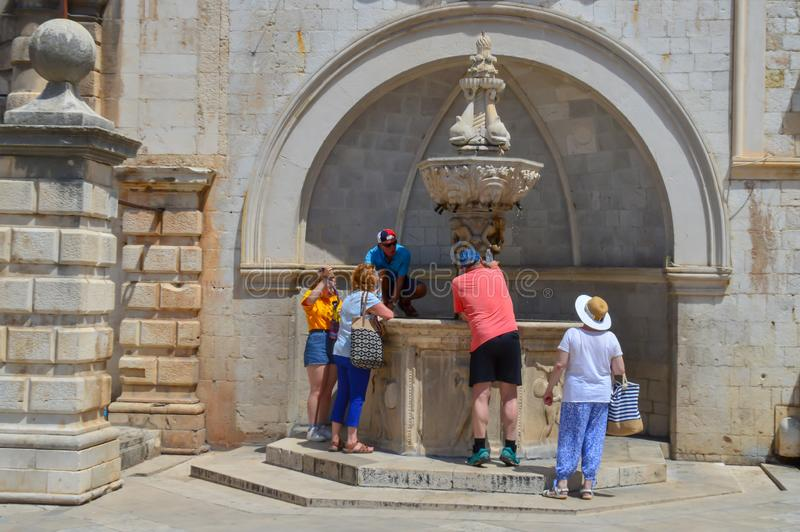 Fountain with fresh cold water near Sponza Palace in ancient town Dubrovnik, Croatia on June 18, 201 royalty free stock image