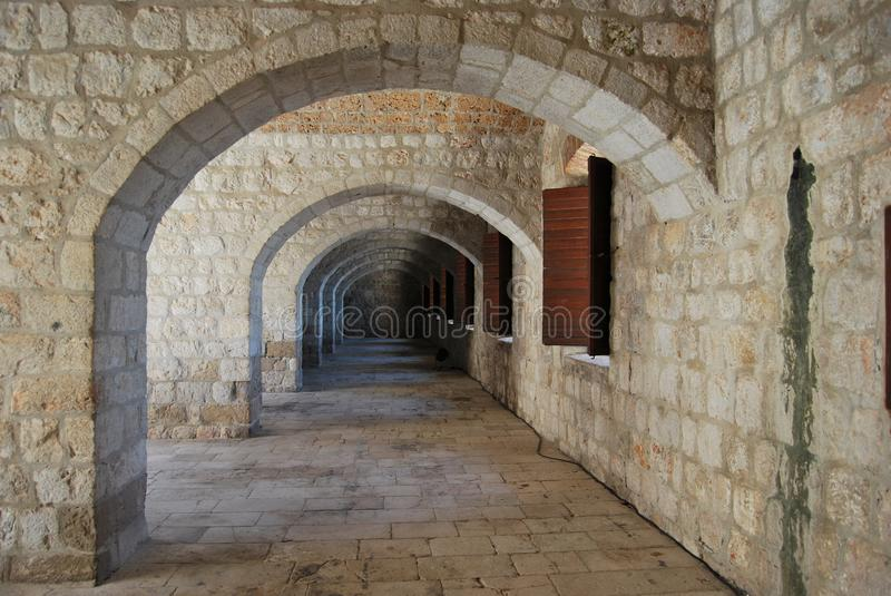 DUBROVNIK, CROATIA - JUNE 2016: Hall with arches inside Fort Lovrijenac royalty free stock photography