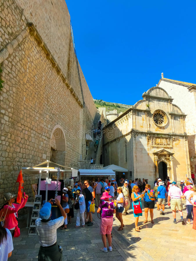 Dubrovnik, Croatia - June 07, 2015: View on the street and old t. Dubrovnik, Croatia - June 07, 2015: The people walking on the street in the old town of royalty free stock photography