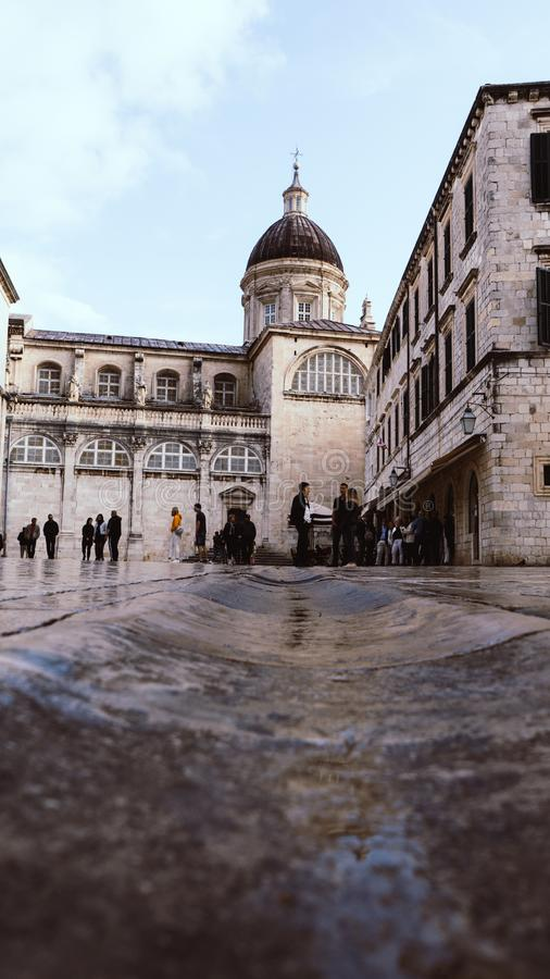 DUBROVNIK/CROATIA - May 01, 2019: Many tourists walk on one of the major streets Stradun in Dubrovnik old town on sunny summer. Day stock photo