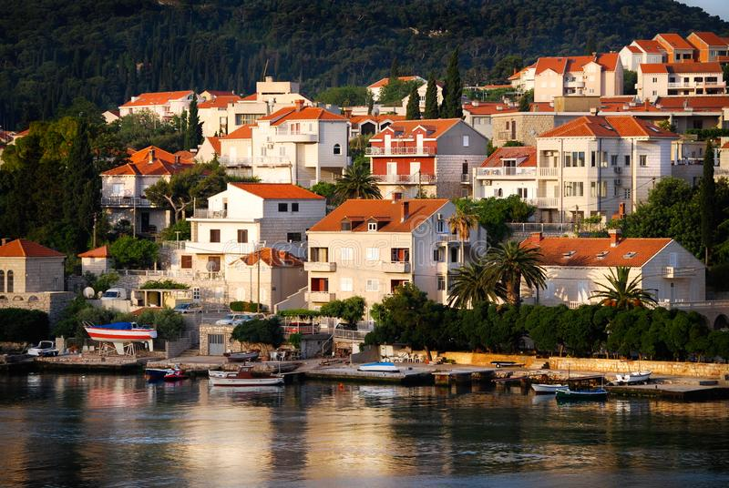 Dubrovnik Croatia Red Tile Roof Houses Along Bay. The red tile roof homes spread out in the area surrounding the Old Town castle of Dubrovnik, Croatia. Small royalty free stock photos