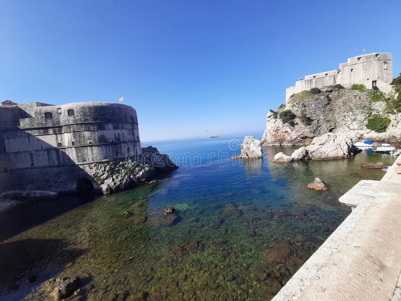 Dubrovnik fortress on Adriatic Sea. Crystalclearsea, rocks royalty free stock photos