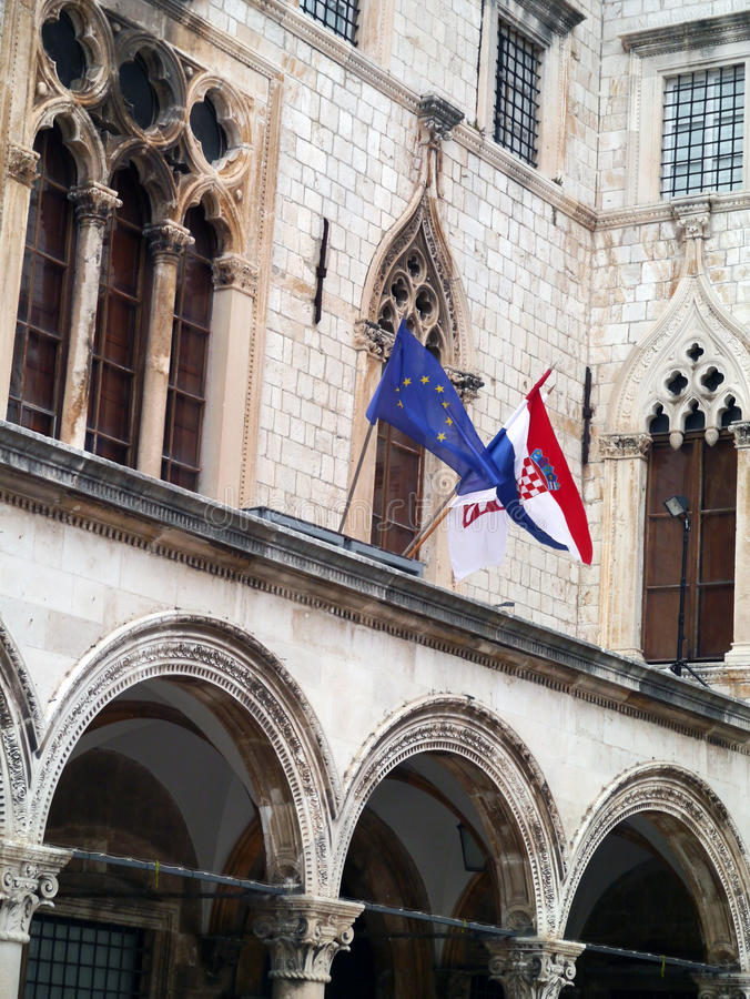 Dubrovnik, Old Town, Croatian and Euro flags royalty free stock images