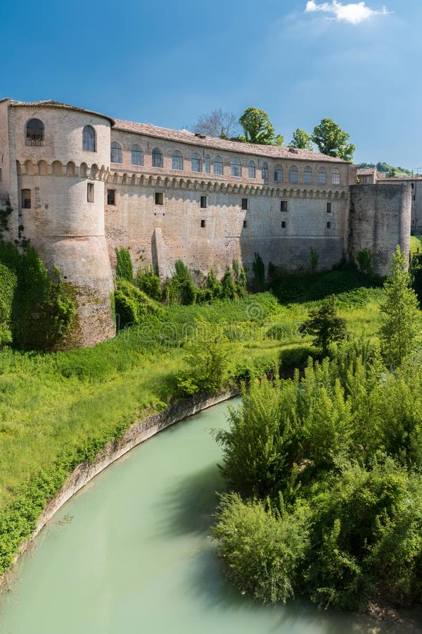 The Ducal Palace of Urbania Marche, Italy over the river Metauro royalty free stock photo