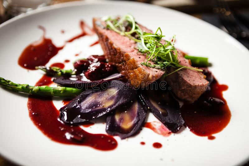 Duck breast served on a plate in restaurant royalty free stock photos