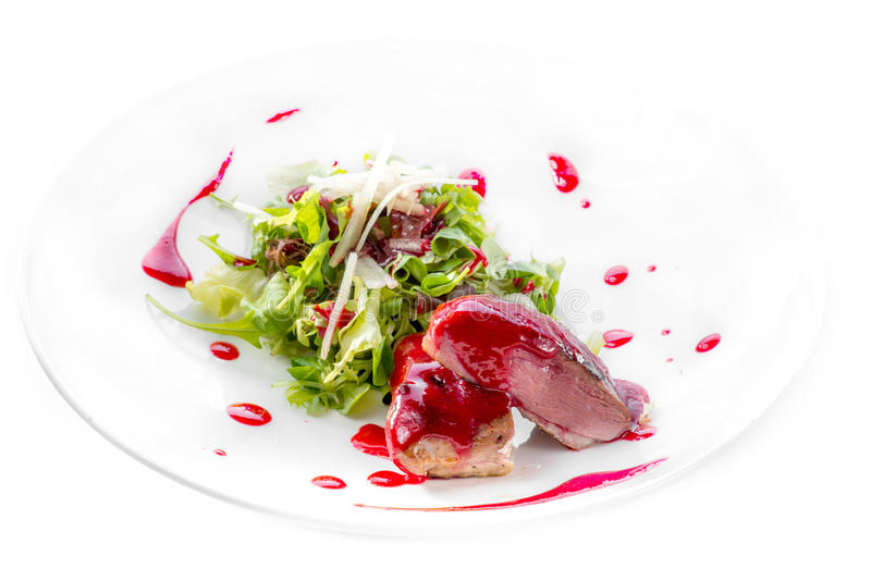 Duck breast with berry sauce and salad royalty free stock image