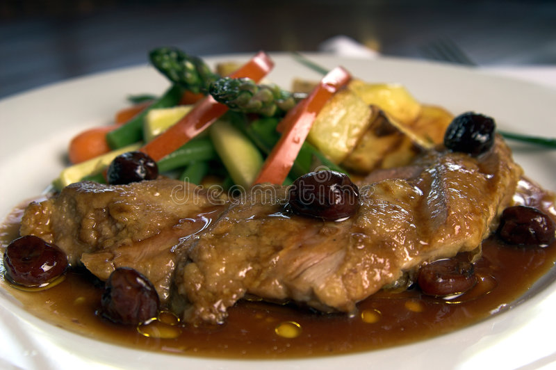 Duck Breast With Cherries stock photos