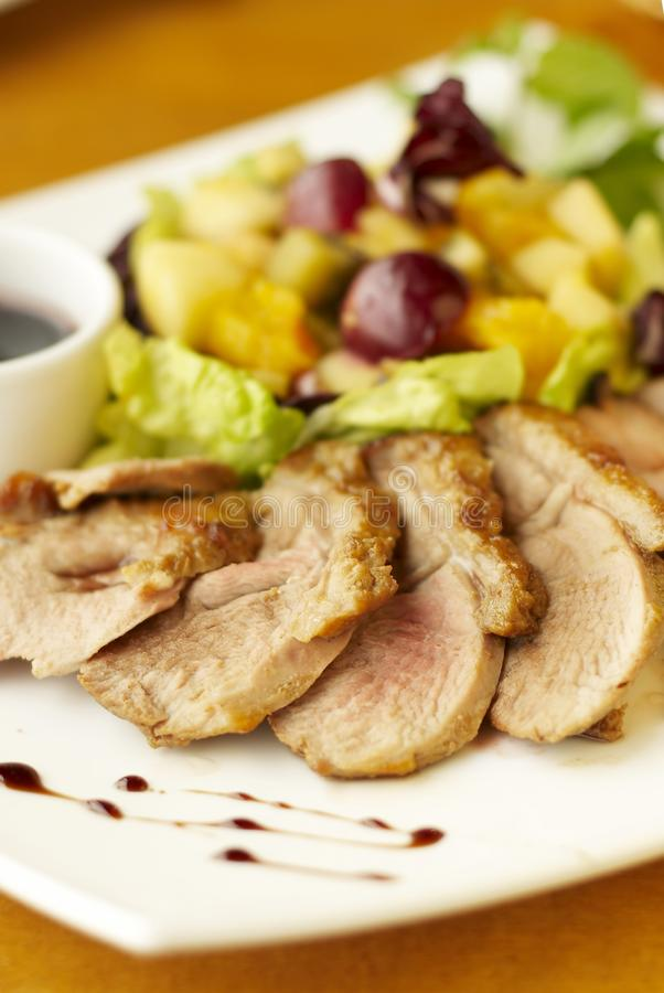 Duck breast with fruit flambe stock photo