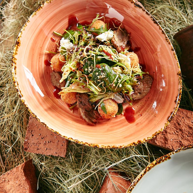 Duck Breast Salad with Crispy Potato Balls royalty free stock photo