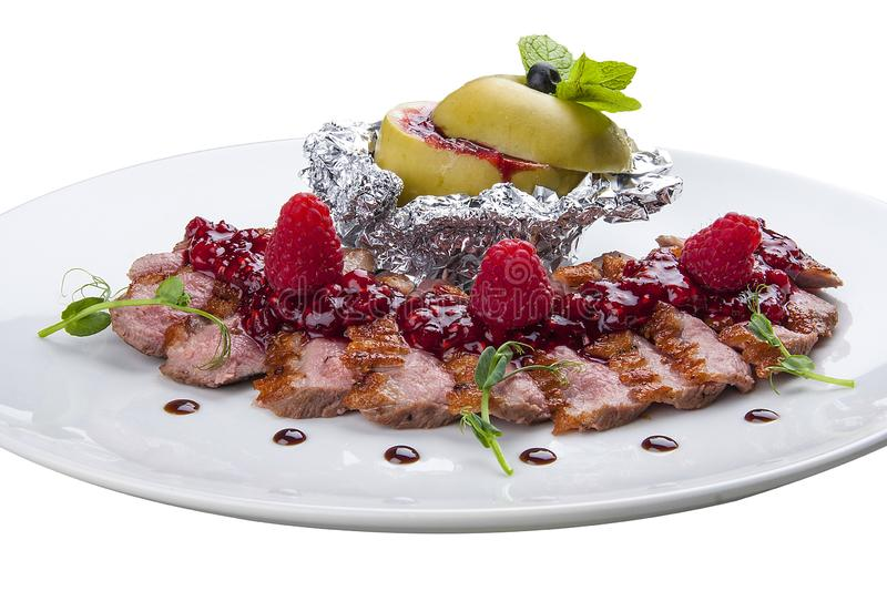 Duck breast with sauce of raspberry. stock photography
