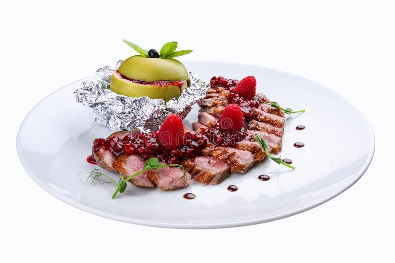Duck breast with sauce of raspberry. stock image