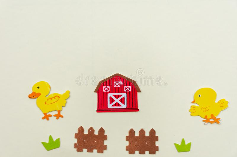 Duck and chicken Farm animals on a flat lay with grass, fence, flowers and a farm house on a white background.  royalty free stock photography