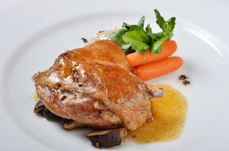 Duck confit. Traditional French dish - Duck confit royalty free stock images