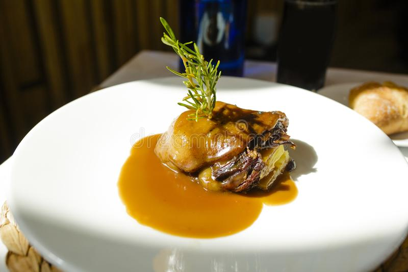 Duck confit dish decorated with rosemary royalty free stock photos