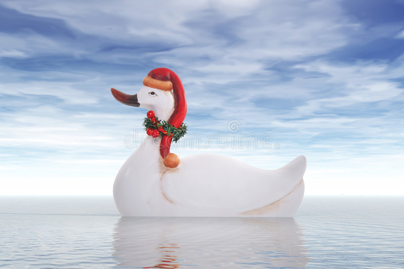 Duck in Santa Claus hat at sea royalty free stock photography