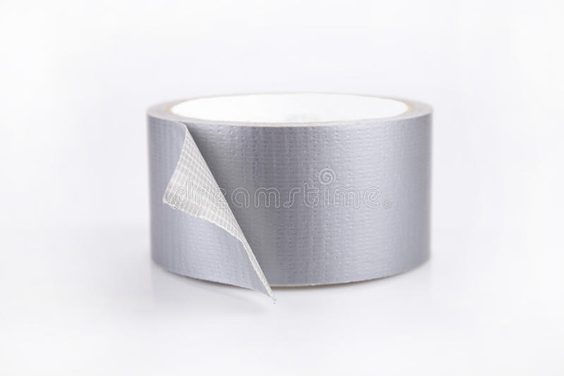 Duct tape. Reel of silver duct tape on a white surface. Roll of duct tape isolated on white background stock photography