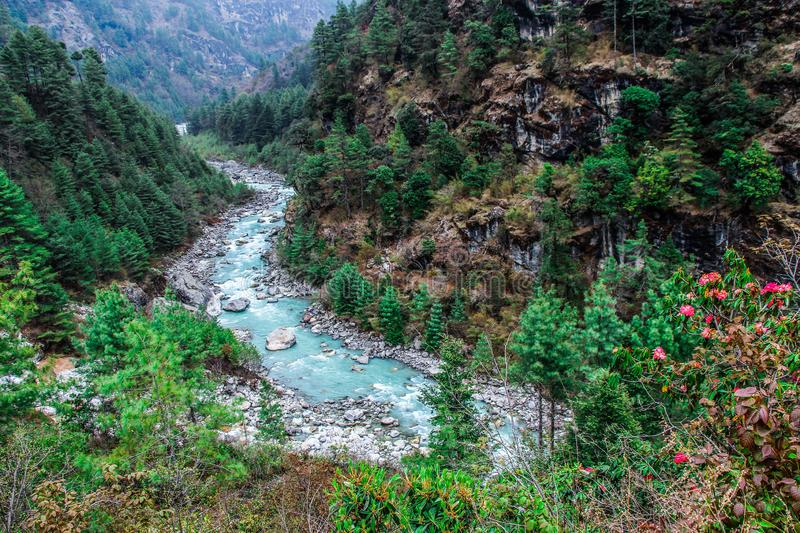 Dudh Koshi snow river in mountain valley in Nepal stock photos