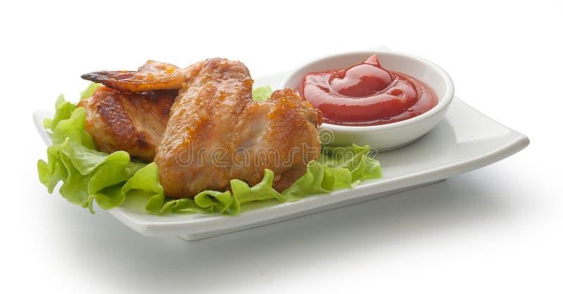 Due ali di pollo fritto fotografie stock libere da diritti