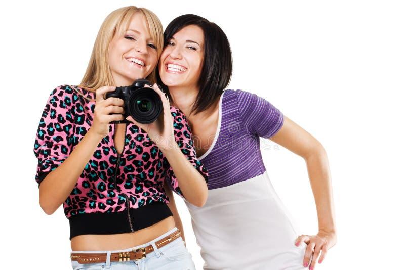 Due amici belli con una macchina fotografica immagine stock libera da diritti