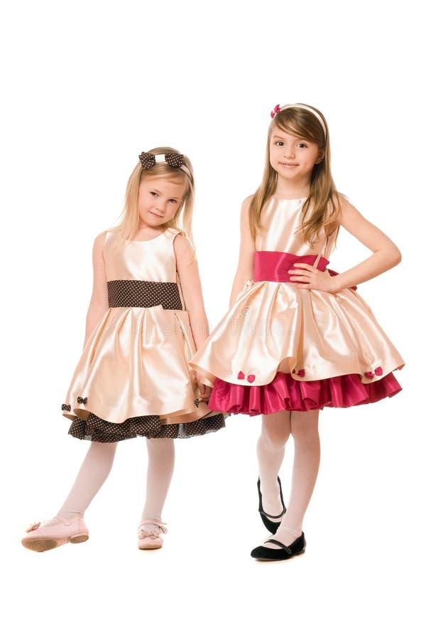 Due bambine sveglie in un vestito fotografia stock
