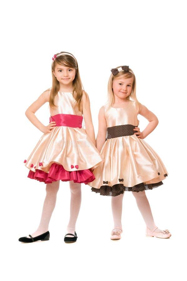 Due belle bambine in un vestito fotografia stock