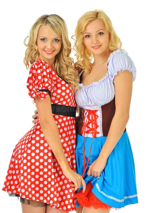 Due belle donne bionde in costumi di carnevale immagini stock