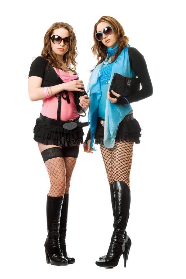 Due belle giovani donne. Isolato fotografie stock