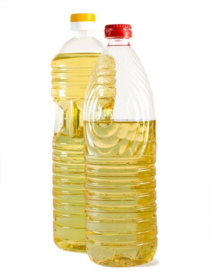Due bottiglie con olio vegetale fotografia stock