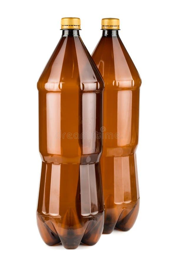 Due bottiglie di plastica vuote marroni fotografie stock